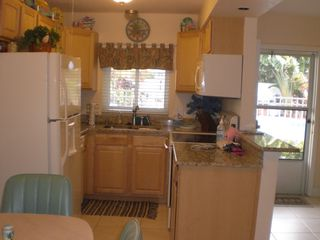 St Pete Beach condo photo - Beautiful kitchen overlooking pool