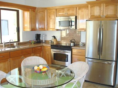 Large kitchen with granite countertops, top of the line appliances.