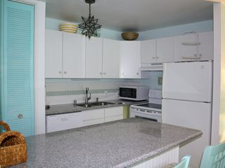 Kahuku - Turtle Bay condo photo - Custom kitchen w/ granite counter tops and full size appliances. Fully stocked.
