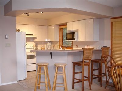 Full Kitchen with all appliances and seating for 4 more at Breakfast Bar