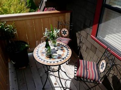 Enjoy morning coffee or an evening libation on the sunny private deck