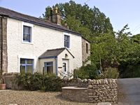 ORCHARD HOLME, pet friendly, with a garden in Priest Hutton, Ref 4148