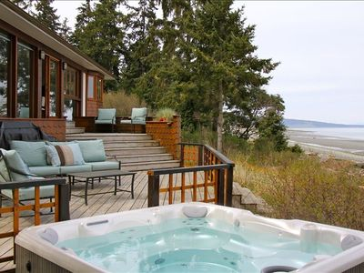 Relax in the hot tub to the sound of waves on the beach a few feet away.