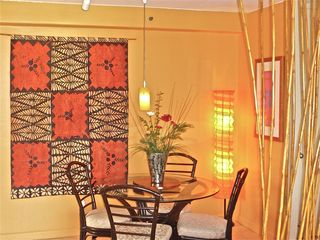 Waikiki condo photo - Dining area with seating for 4. A beautiful Tongan tapa cloth adorns the wall