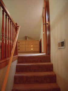 Staircase leading to private room & bath on second floor