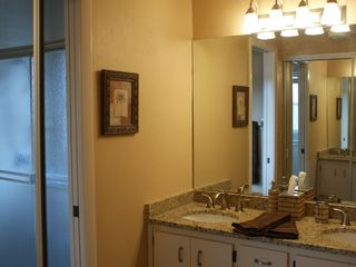Vacation Homes in Marco Island house photo - Master BR/Bath-Tiled shower&toilet w/Dbl granite-top Lavs
