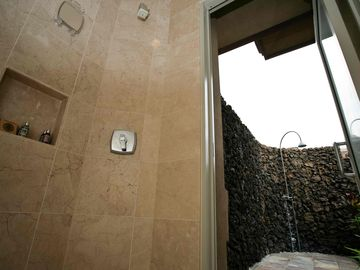 Incredible outdoor shower with volcanic rock tile