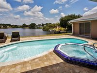 Elegant and Relaxing 3BR Port Charlotte House w/Private Outdoor Pool + Spa, Beautiful Lanai & Lake Views - Minutes to Gulf Beaches, Golf and Much More!