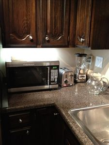 All new stainless steel appliances for making coffee and smoothies before skiing