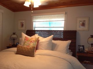 Islamorada cottage photo - The master bedroom sleeps two people. It offers nice views of the canal.