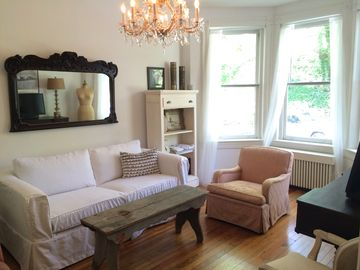 Dupont Circle townhome rental - The living room, with crystal chandelier.