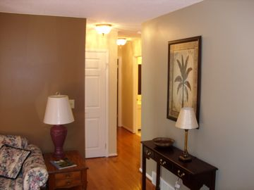 View looking into hallway leading to bedrooms & bathrooms.