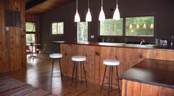 East Hampton cabin rental - Open plan kitchen with great views to outdoor deck and pool area.