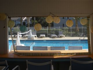 St. Simons Island condo photo - Party cabana beside the back and kiddie pools.