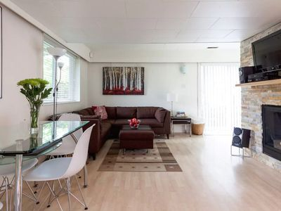 Bright, Modern 1 Bedroom Suite with Cozy Gas Fireplace on Beautiful Park