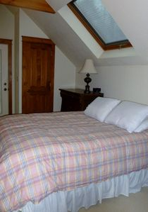 Upstairs Bedroom has a queen size bed and brand new bedding to welcome you!