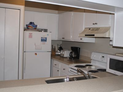 New Solid Surface Counters, Microwave, Dishwasher, Washer and Dryer