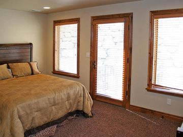 Queen Bedroom upstairs with separate exterior entrance.
