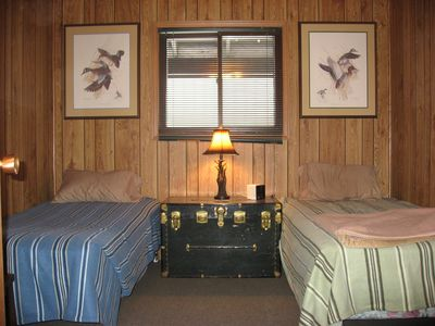 Twin bedroom in the main lodge.