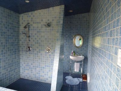 2nd floor all tile Spa tub bathroom with walk in shower with heated floor.