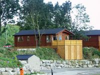 LAKELAND CABIN, with pool in South Lakeland Leisure Village, Ref 1484