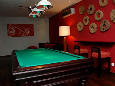 Billiard room with TV and fridge for the beers