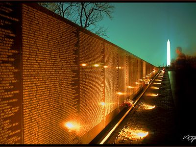 Nighttime view of the Viet Nam Memorial and the Washington Monument