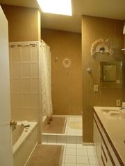 Kailua studio photo - Tile bathroom with jacuzzi tub, walk in shower and twin vanities