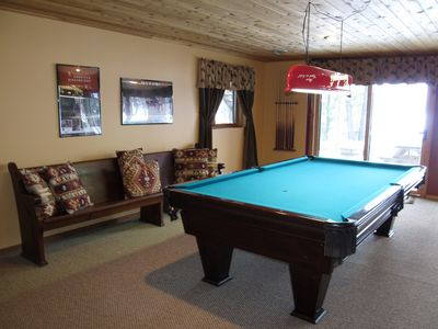 Great pool table on lower level, walk out to patio, gas fireplace & TV