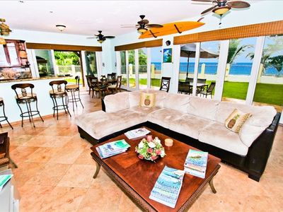 Spacious oceanfront living area walks out to the heated pool & white sand be