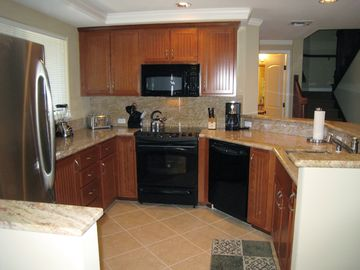 The kitchen - fully equipped, granite counters