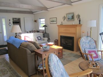Living room that runs the length of the cottage.