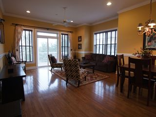Folly Beach townhome photo - Living area complete with wood floors, high-ceilings and plenty of natural light