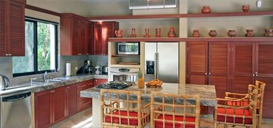 Gourmet kitchen with state-of-the-art stainless steel appliances