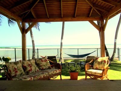 Gazebo with bar and seating Hammocks loungers all in private oceanfront backyard