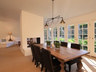 Malibu house photo - Large dining room, with seating up to 8. French doors connect to lush outdoors.