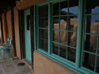 Santa Fe cottage photo - Front patio overlooking courtyard garden where you'll find a gas grill