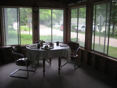 Enjoy breakfast on the screened in porch