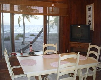 Dining room with bay window overlooks gulf sunsets