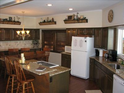 Recently remodeled kitchen with everything you need to cook. Gas grill outside.