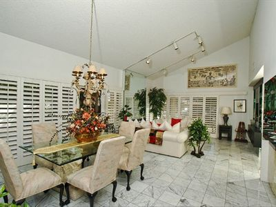 Looking thru dining & living room, marble floors, plantation shutters