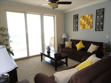 Tropic Winds condo rental - Living Room with a great view of the Dolphins passing by.
