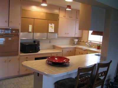 The 1957 kitchen with original tile, custom fridge, range/stove, plug in griddle