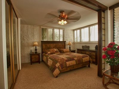 Master bedroom - California King Size bed - with brown bed spread.