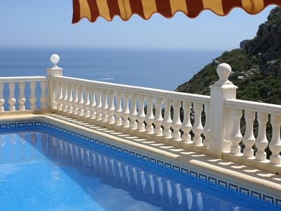 Take a dip in the heated pool - with direct sea views!