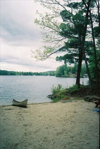 Photo from the front of the cottage of Sokokis Lake and canoe.