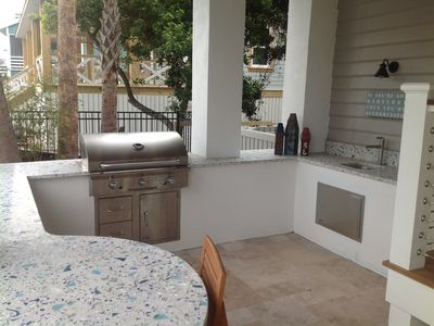 New outdoor kitchen with grill, sink, and recycled glass countertop