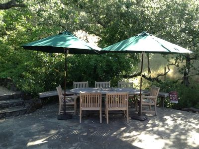 Lower patio dining area under beautiful oak trees