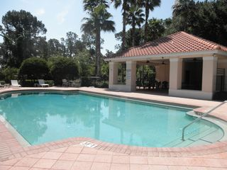 Esprit Estates villa photo - Large Community Pool with Picnic Area and Dressing Rooms