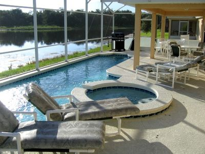 Swimming pool area overlooking lake w/BBQ and spa